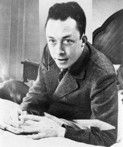 Albert Camus fue un novelista, ensayista, dramaturgo, filósofo y periodista francés nacido en Argelia. Sus concepciones se formaron bajo el influjo de Schopenhauer, de Nietzsche y del existencialismo alemán.  Se le ha atribuido la conformación del pensamiento filosófico conocido como absurdismo, si bien en su texto «El enigma» el propio Camus reniega de la etiqueta de «profeta del absurdo». Se le ha asociado frecuentemente con el existencialismo, aunque Camus siempre se consideró ajeno a él. Pese a su alejamiento consciente con respecto al nihilismo, rescata de él la idea de libertad individual.